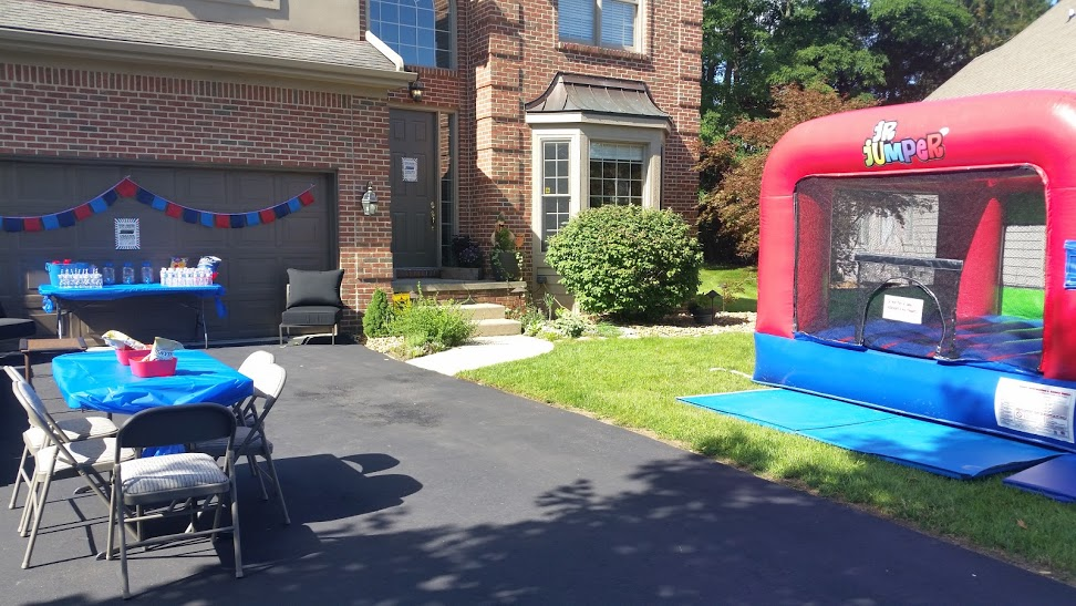 Front yard with bounce house